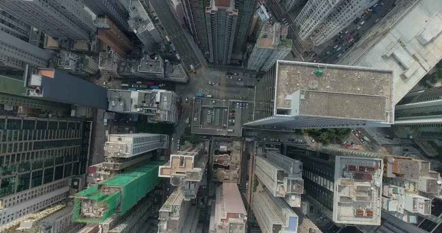 Top view aerial footage from flying drone of metropolitan city HongKong with development buildings, transportation, energy power infrastructure. Financial and business centers in developed China town.