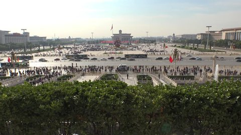 Largest square Tiananmen Square famous public space. Centre of Beijing China. People enter to Forbidden City. Sunny Summer day. Aerial view from above. Road traffic. Assent
