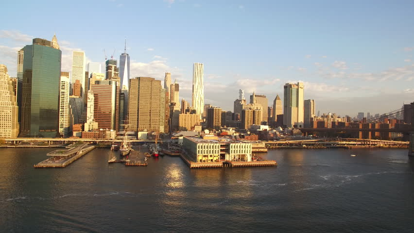 NEW YORK - OCTOBER 16: The Skyline of New York.  The camera rises above the the skyscrapers and all the financial buildings and gives a view over Manhatten and the Brooklyn Bridge.