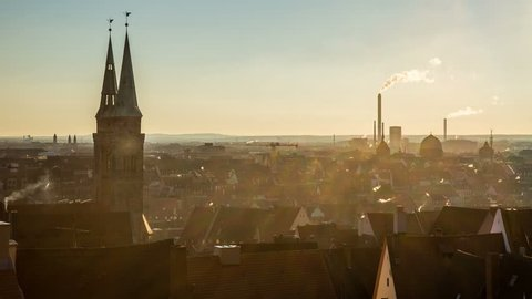 NUREMBERG, GERMANY – May 24, 2015: Church and old town in the sunset timelapse a view on the old town nuremberg with red roofs and St. Sebald church from evening to night time lapse