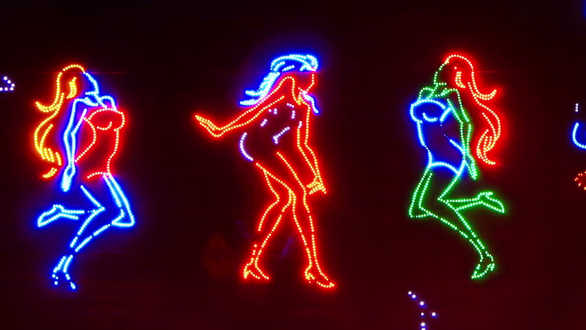 Dancing Girls Neon Sign Stock Footage Video (100% Royalty