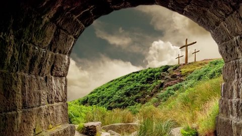 Three wooden crosses on a hill seen from the empty grave. Easter Resurrection Background.