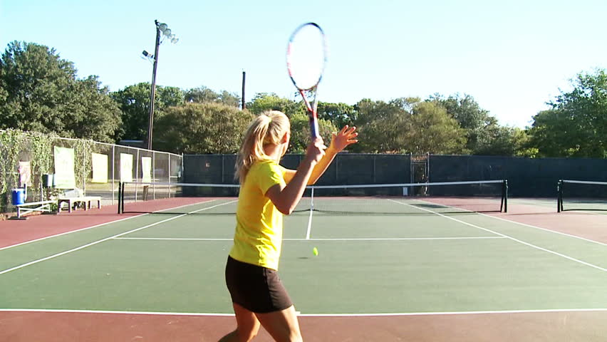 Slow motion of young women playing tennis. Zooming in and out to the ball. | Shutterstock HD Video #2417342