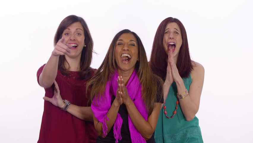 Three women point and laugh. Medium shot on white background.