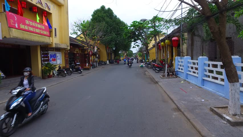 Hoi An, Vietnam - February, 2016: Outdoor markets in the streets of Hoi An, Vietnam. | Shutterstock HD Video #24221062