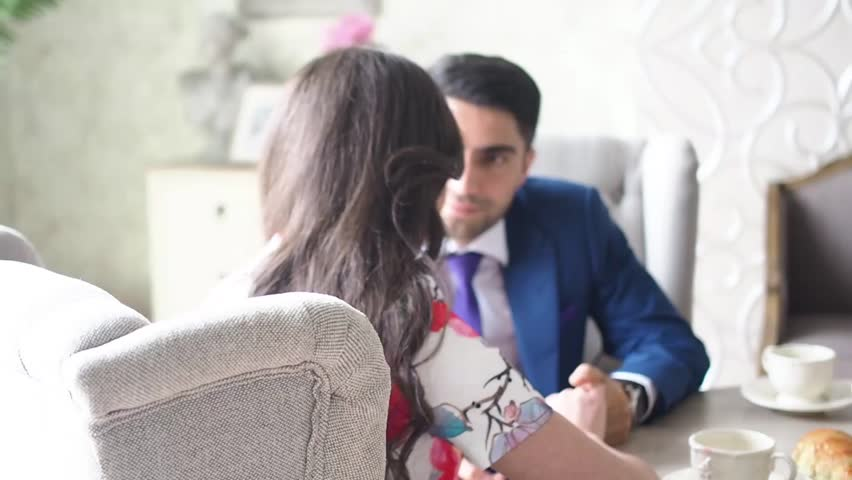 Man and woman looking at each other sitting at the table   Shutterstock HD Video #24280457