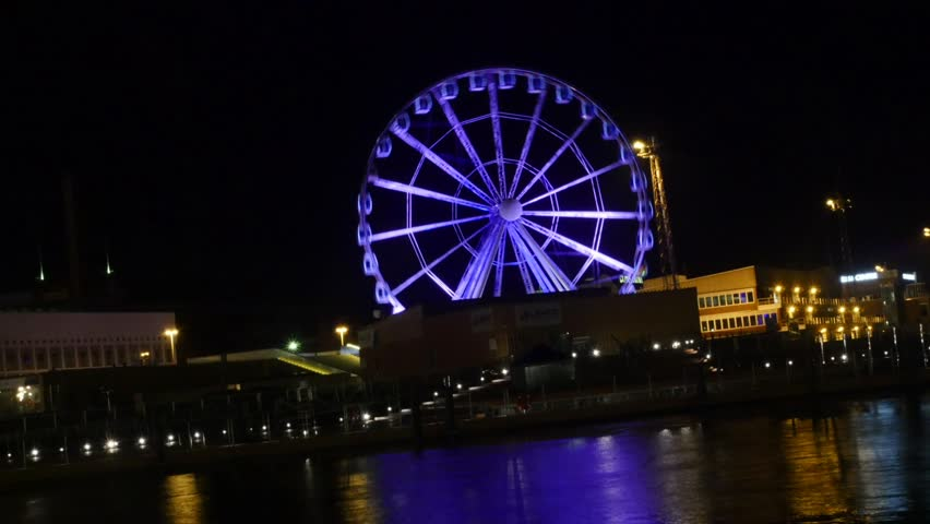Zooming timelapse of purple color, Helsinki skywheel, at a dark new years evening night, in Helsinki, Finland.
