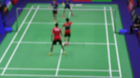 Badminton players in action - changing shuttlecock strategy