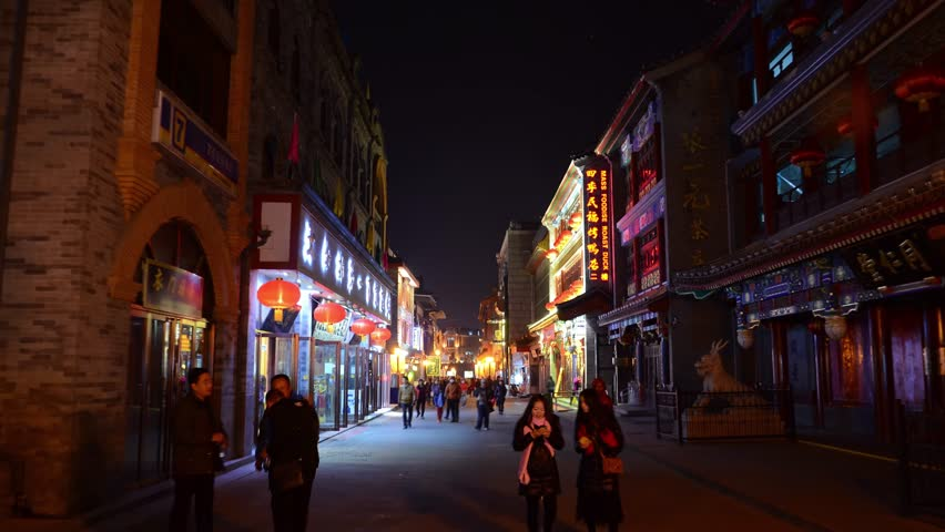 Hyperlapse pedestrian street in Beijing China. Night colorful illumination. Shops and cafeteria street food. Authentic old Chinese architecture. Forward movement smooth.