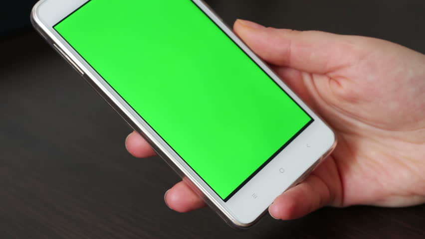 Touch Screen On White Smartphone Green Screen.Using Smartphone,Holding Smartphone with Green Screen