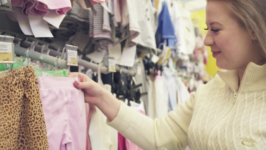 b20574d01 Young Happy Pregnant Woman Choosing Stock Footage Video (100 ...