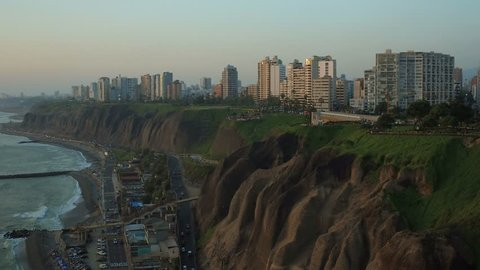 Lima Peru Aerial v62 Flying low besides Miraflores cliff side parks panning with beach views.
