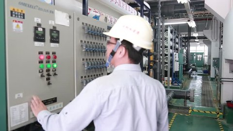 Penghu, Taiwan-03 November, 2014: An operator is controlling the reverse osmosis system in a water plant in Penghu, Taiwan. Reverse osmosis and nanofiltration are pressure-driven separation processes.