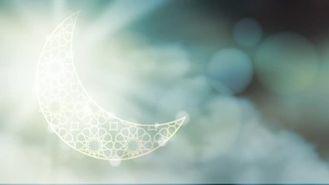 Glittering ornamental moon with moving clouds bokeh effect.  HD graphic animation for muslim holiday holly month Ramadan Kareem.