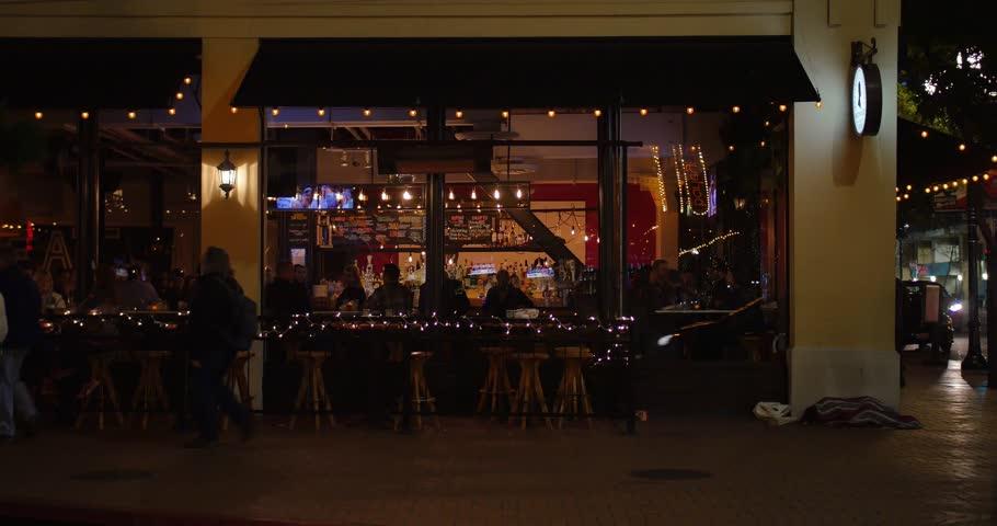 SAN DIEGO, CA - Circa February, 2017 - A night establishing shot of a typical upscale restaurant on Fifth Avenue in San Diego's Gaslamp Quarter.