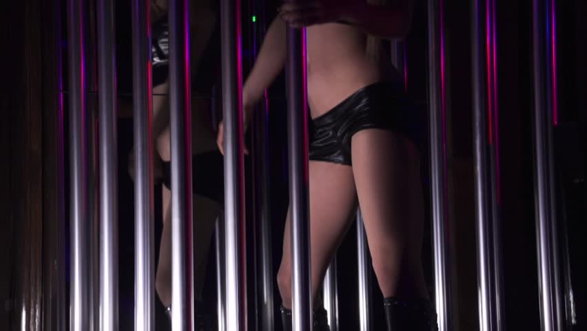 Girl is dancing in dj disco club. Nude beautiful women dance striptease in night club