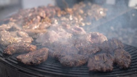 People cook barbecue grill, grilled steak, Frying fresh meat, Chicken BBQ, sausage, kebabs, hamburger, picnic with mushrooms and meat