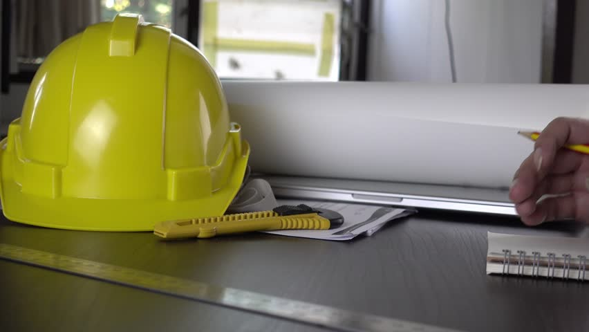 Blueprints and safety helmet over a table in construction site engineer wokring on paper plan and blueprint document 4k stock footage clip malvernweather Gallery