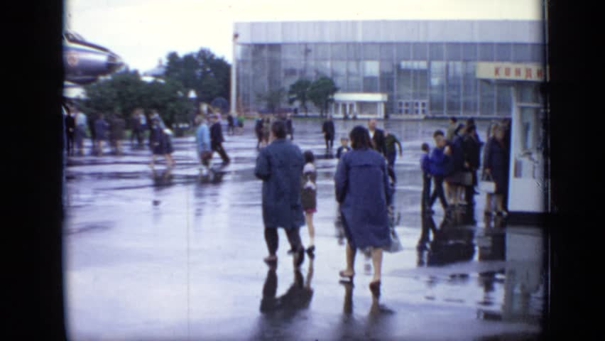 MOSCOW RUSSIA 1971: various families and groups of people walking through outdoor air show | Shutterstock HD Video #24419453