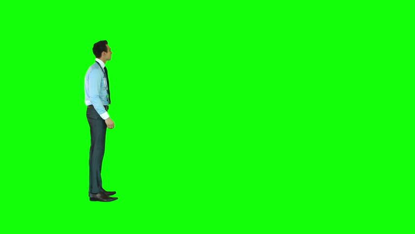 Businessman using digital screen against green background | Shutterstock HD Video #24434252