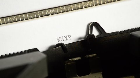 Typing the word WHY with question mark with an old manual typewriter