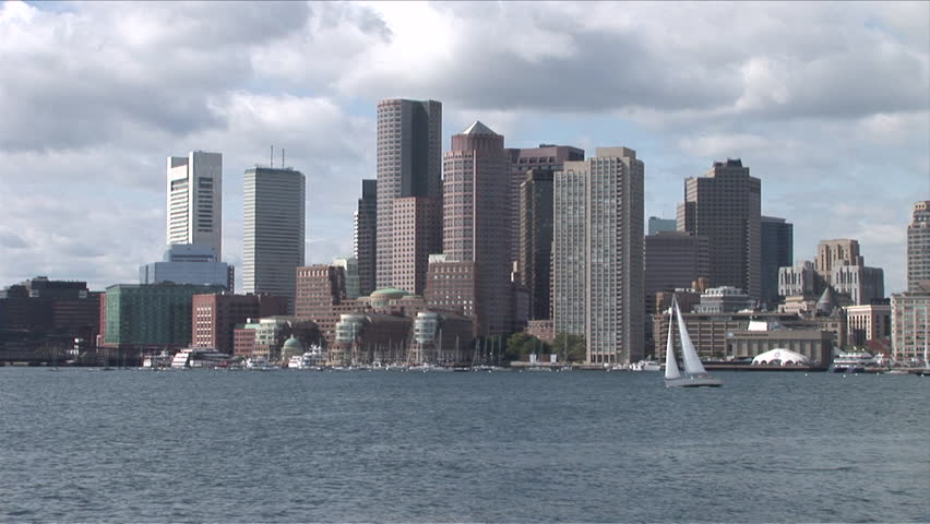 View of the skyline of Boston with boats in the water
