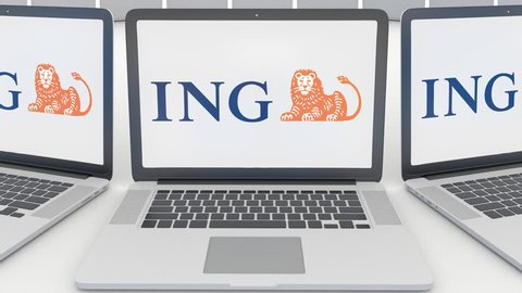 Laptops with ING Group logo on the screen. Computer technology conceptual editorial 4K clip, seamless loop