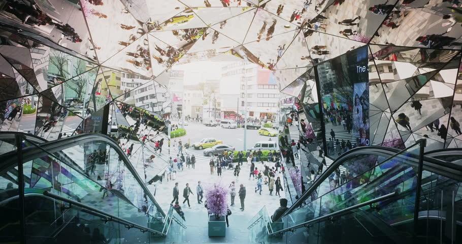 Vibrant mirror street reflections at Omohara Tokyu Plaza fashion mall in Harajuku