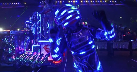 Tokyo - March 2016 : Futuristic LED dancers during the Robot Restaurant robotic laser light cabaret show in Kabukicho