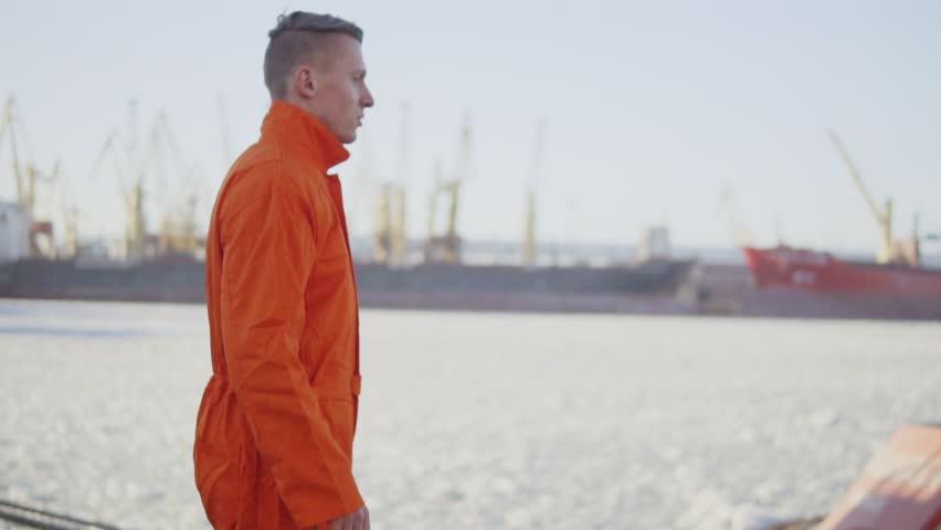 Harbor Worker is Walking on Cargo Harbor Site. Slowmotion | Shutterstock HD Video #24666632