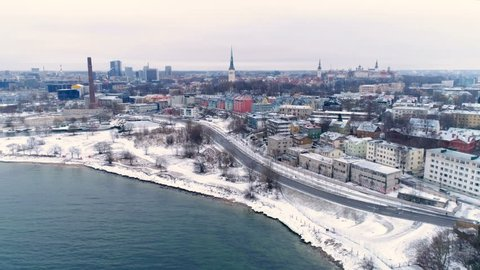 The aerial view of the old Tallin city in Estonia where the capital of the city is located seen the buildings and houses on a snowy winter season