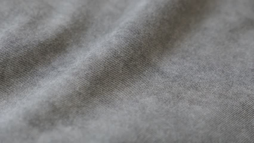 Shiny gray modern clothing sample 2160p 30fps UltraHD panning footage - Dark grey smoked color fine t-shirt fabric  slow pan 4K 3840X2160 UHD video