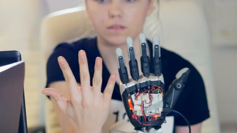 Human arm with robot arm. Futuristic robotic cyber technolgy roday.