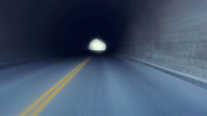 Soft focus drive through a tunnel into the light