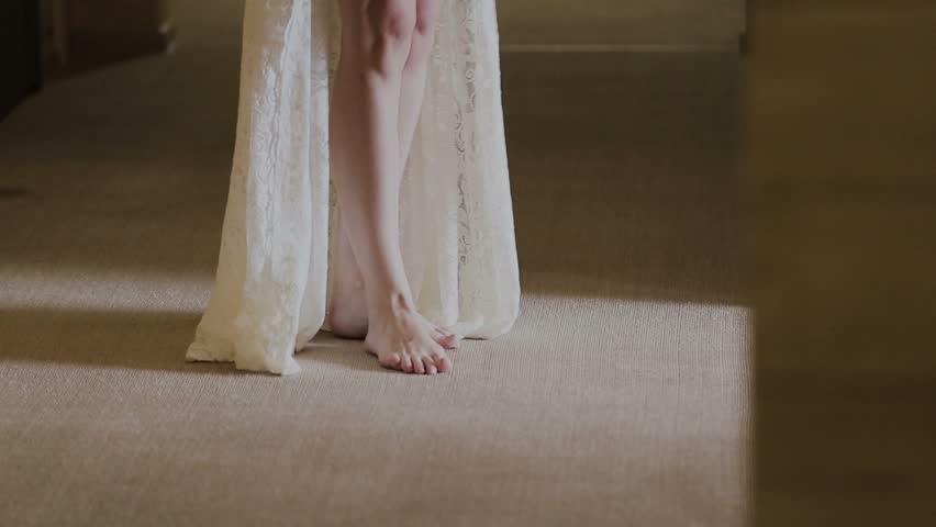Legs of a woman in a white coat | Shutterstock HD Video #24699962