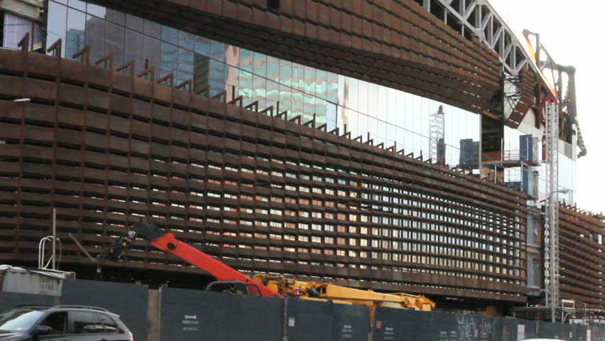 BROOKLYN, NY - FEBRUARY 15, 2012: Busy traffic goes by the construction of the Barclays Center in Brooklyn, NY