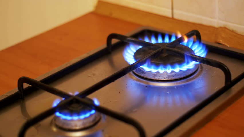 Ignition Of The Gas In Burner On Home Kitchen Stove White