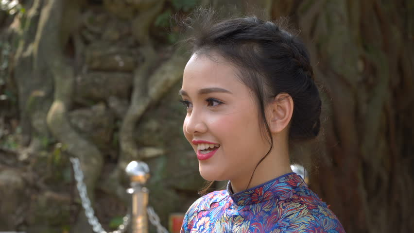 A young and pretty girl of Asian nationality. A girl in beautiful national clothes.