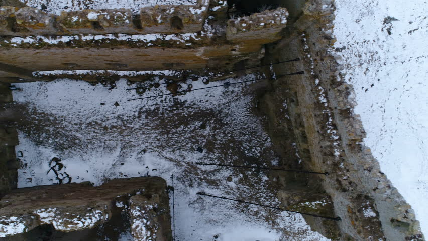 Aerial view of the old ruined Toolse castle with no more roof and the white snow inside the castle in Lahemaa park Estonia