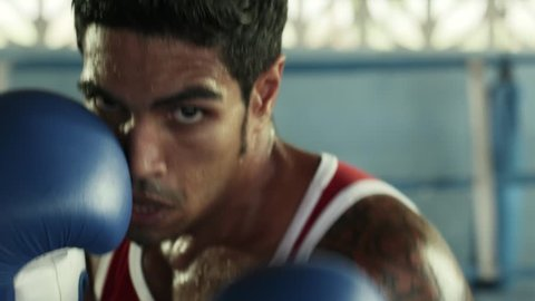 Sports and people, young male athlete training in boxing gym