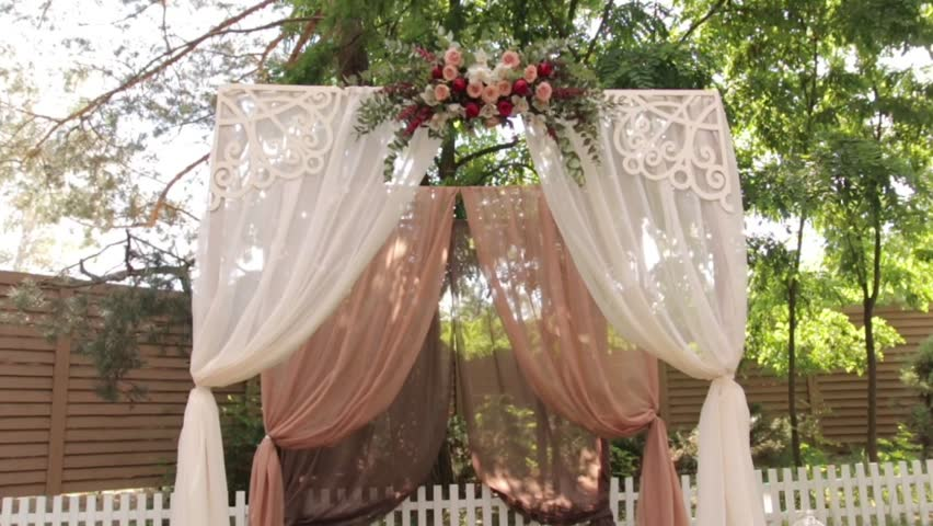 Outdoor wedding setting for celebration of becoming family wedding arch with flowers hd stock video clip junglespirit Gallery