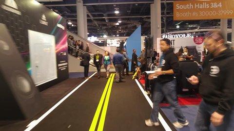 LAS VEGAS - January 07, 2017: Dynamic hectic hyperlapse walk through CES 2017 show floor in Las Vegas, Nevada. SEC is an annual consumer electronics trade show. 4K UHD timelapse.
