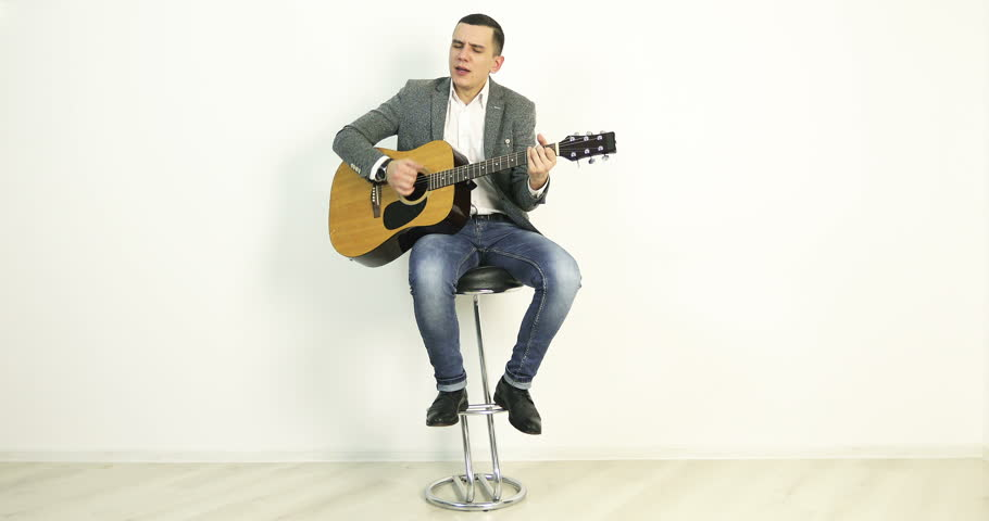 4K A young man in a jacket sits on a bar stool and plays an acoustic  sc 1 st  Shutterstock & Man Sitting On Stool Stock Footage Video | Shutterstock islam-shia.org