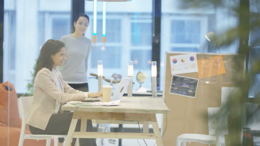4K Confident successful businesswomen in a meeting looking over paperwork | Shutterstock HD Video #24905147