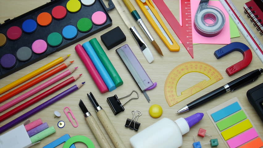 Desk with school stationary or office tools. Flat lay set of artist school stationery studio shot on school table background. School equipment concept.