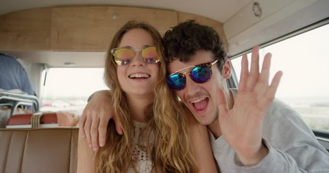 Portrait Beautiful teenage hipster friends posing for camera smiling at festival in camper van on road trip adventure
