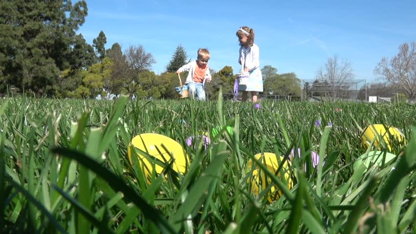 Slow motion of kids having fun gathering eggs at Easter hunt #24973232