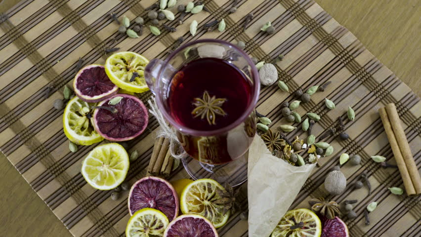 Wine in a glass, spices and fruit for mulled wine. Rotation counter-clockwise | Shutterstock HD Video #24987392