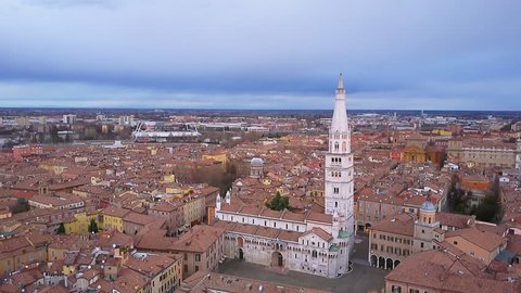 modena skyline aerial view flying towards the main cathedral tilt down