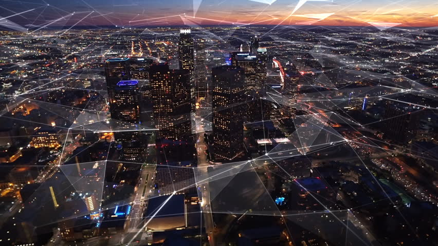 Connected aerial view of the Financial District in Downtown Los Angeles, California.  Sunset. Famous skyscrapers and freeway full of cars. Futuristic. Technology. Shot from helicopter. | Shutterstock HD Video #25021232